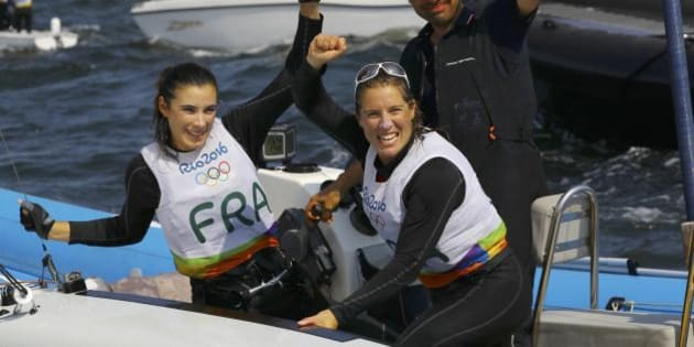 2016 Rio Olympics - Sailing - Final - Women's Two Person Dinghy - 470 - Medal Race - Marina de Gloria - Rio de Janeiro, Brazil - 18/08/2016. Camille Lecointre (FRA) of France and Helene Defrance (FRA) of France celebrate bronze medal. REUTERS/Brian Snyder  FOR EDITORIAL USE ONLY. NOT FOR SALE FOR MARKETING OR ADVERTISING CAMPAIGNS.