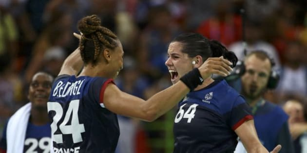 2016 Rio Olympics - Handball - Semifinal - Women's Semifinal Netherlands v France - Future Arena - Rio de Janeiro, Brazil - 18/08/2016. Beatrice Edwige (FRA) of France and Alexandra Lacrabere (FRA) of France celebrate after the match. REUTERS/Alkis Konstantinidis FOR EDITORIAL USE ONLY. NOT FOR SALE FOR MARKETING OR ADVERTISING CAMPAIGNS.