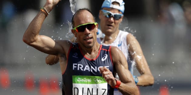 Yohann Diniz, of France, splashes water onto his head during the men's 50-km race walk at the 2016 Summer Olympics in Rio de Janeiro, Brazil, Friday, Aug. 19, 2016. (AP Photo/Robert F. Bukaty)
