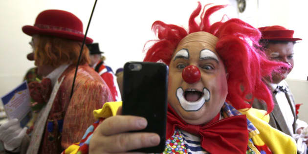 A clown takes a selfie at the All Saints Church hall before the Grimaldi clown service in Dalston, north London, February 7, 2016. The Clowns International 70th annual service brings together professional clowns from Britain and Europe in a service of remembrance to the famous British clown Joseph Grimaldi, who died in 1837.  REUTERS/Peter Nicholls
