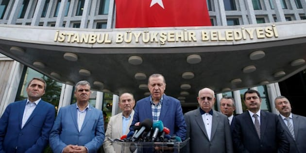 ISTANBUL, TURKEY - AUGUST 21: Turkish President Recep Tayyip Erdogan (C) speaks to media as Istanbul Mayor Kadir Topbas (3rd L), Turkish Deputy Prime Minister Veysi Kaynak (2nd L), the Governor of Istanbul, Vasip Sahin (2nd R), AK Party Istanbul Provincial Chairman Selim Temurci (L) and Speaker of the Grand National Assembly of Turkey, Ismail Kahraman (4th R) stand next to him at Istanbul Metropolitan Municipality in Istanbul, Turkey on August 21, 2016. (Photo by Erhan Elaldi/Anadolu Agency/Getty Images)
