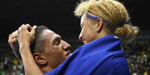 2016 Rio Olympics - Boxing - Final - Men's Super Heavy (+91kg) Final Bout 273 - Riocentro - Pavilion 6 - Rio de Janeiro, Brazil - 21/08/2016. Tony Yoka (FRA) of France celebrates with fellow gold medallist Estelle Mossely of France (FRA) after winning his bout. REUTERS/Peter Cziborra FOR EDITORIAL USE ONLY. NOT FOR SALE FOR MARKETING OR ADVERTISING CAMPAIGNS.