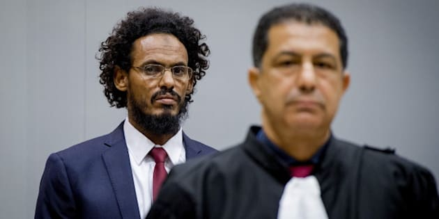 Ahmad Al Faqi Al Mahdi ( a.k.a. Abu Tourab) enters the courtroom of the International Criminal Court (ICC) in the Hague the Netherlands, September 30,2015. Abu Tourab is suspected of attacking mosques and monuments in the ancient Malian city of Timbuktu and has been handed over to the International Criminal Court, the first ever detained for wrecking cultural heritage. REUTERS/Robin van Lonkhuisen/Pool      TPX IMAGES OF THE DAY
