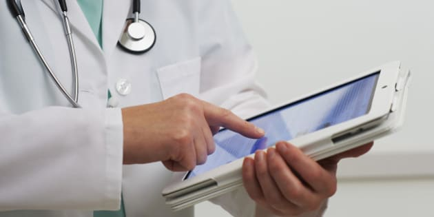 Healthcare professional using digital tablet computer