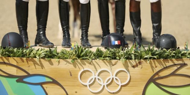 2016 Rio Olympics - Equestrian - Victory Ceremony - Jumping Team Victory Ceremony - Olympic Equestrian Centre - Rio de Janeiro, Brazil - 17/08/2016. Gold medalists Roger-Yves Bost (FRA) of France, Penelope Leprevost (FRA) of France, Kevin Staut (FRA) of France and Philippe Rozier (FRA) of France during the victory ceremony. REUTERS/Damir Sagolj  TPX IMAGES OF THE DAY  FOR EDITORIAL USE ONLY. NOT FOR SALE FOR MARKETING OR ADVERTISING CAMPAIGNS.