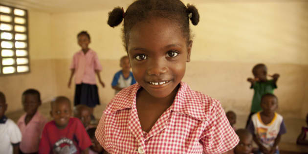 Young female 5-7 in Haiti smiling in her classroom