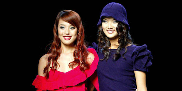SHANGHAI, CHINA:  Chinese models present creations by French fashion house Sonia Rykiel during the 2004 Shanghai Fashion Week in Shanghai, late 24 October 2004.   AFP PHOTO/LIU Jin  (Photo credit should read LIU JIN/AFP/Getty Images)