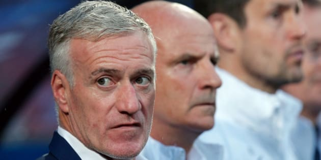 France coach Didier Deschamps, left, wait for the start of the friendly soccer match between France and Scotland at the Saint Symphorien Stadium in Metz, eastern France, Saturday, June 4, 2016. The French squad is in preparation for the EURO 2016 soccer championships which will start on June 10, 2016. (AP Photo/Thibault Camus)
