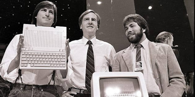 FILE - In this April 24, 1984, file photo, Steve Jobs, left, chairman of Apple Computers, John Sculley, center, president and CEO, and Steve Wozniak, co-founder of Apple, unveil the new Apple IIc computer in San Francisco. Apple has turned 40, and it's a very different company from the audacious startup that Jobs and Wozniak launched in a Silicon Valley garage in 1976. (AP Photo/Sal Veder, File)