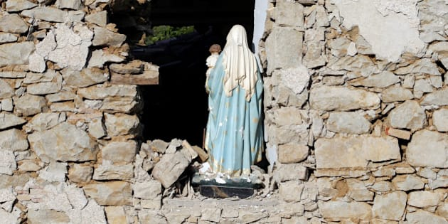A Virgin Mary statue is seen in a church following an earthquake at Cossito near Amatrice, central Italy, August 26, 2016. REUTERS/Max Rossi