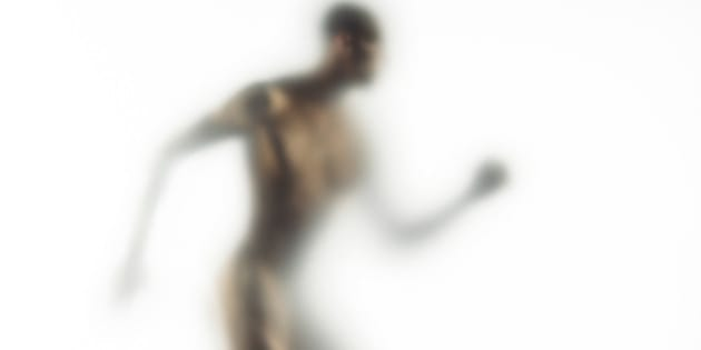 Naked young man walking (defocussed)