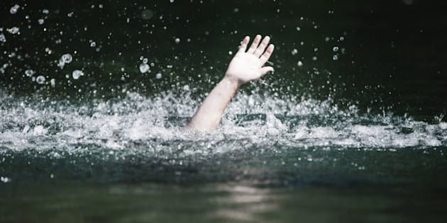 Moving Hand of Someone Drowning and in Need of Help