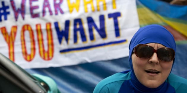 A woman wearing a 'Burkini' joins a protest outside the French Embassy in London on August 25, 2016, during a 'Wear what you want beach party' to demonstrate against the ban on Burkinis on French beaches and to show solidarity with Muslim women.