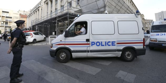 Police vans carrying soccer fans arrive at a police station in Marseille, France, Tuesday, June 14, 2016. A bus carrying Russian fans has been detained near the French city of Nice amid concerns over hooligan violence after Russian fans attacked English supporters last week. (AP Photo/Claude Paris)