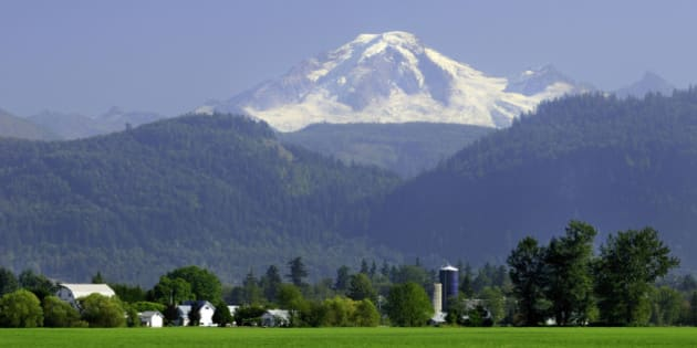 Farms, barns and silo's with Mt. Baker in the background, Abbotsford, British Columbia, Canada.