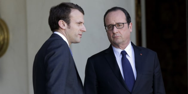 French President Francois Hollande (R) speaks with Economy minister Emmanuel Macron after a meeting with Telecom equipment maker Alcatel-Lucent CEO Combes and Nokia's President and CEO Suri at the Elysee Palace in Paris April 14, 2015. Nokia Oy is in talks to buy smaller telecom equipment maker Alcatel-Lucent, a deal that would combine the industry's two weakest players but could pose challenges in cutting costs and overcoming political opposition. REUTERS/Philippe Wojazer