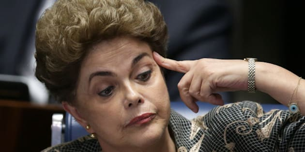Suspended Brazilian President Dilma Rousseff reacts during her impeachment trial at the Federal Senate in Brasilia, Brazil, Monday, Aug. 29, 2016. Rousseff's scheduled appearance during her impeachment trial is the culmination of a fight going back to late last year, when opponents in Congress presented a measure seeking to remove her from office. Her accusers say she hurt the economy with budget manipulations; she argues she did nothing wrong and is being targeted by corrupt lawmakers. (AP Photo/Eraldo Peres)