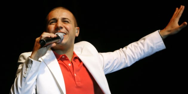 French-Algerian singer Faudel performs during a concert in the west bank city of Ramallah July 9, 2008. REUTERS/ Fadi Arouri (WEST BANK)