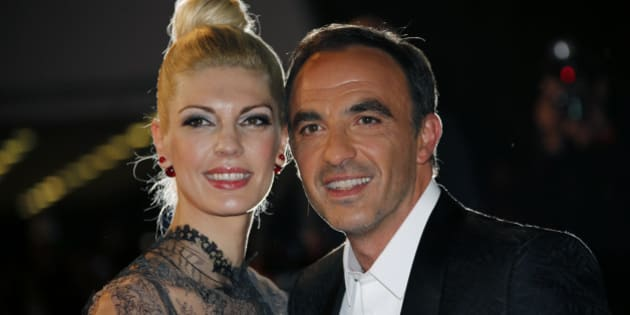 TV host Nikos Aliagas and his wife Tina Grigoriou arrive for the NRJ Music Awards ceremony at the Festival Palace in Cannes December 13, 2014.  REUTERS/Eric Gaillard (FRANCE - Tags: ENTERTAINMENT)