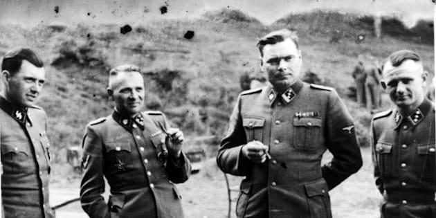 UNSPECIFIED - CIRCA 1754: Dr Josef Mengele (1911-1979) left, known as 'The Angel of Death' for the medical experiments he carried out on the inmates of Auschwitz, the German Nazi concentration. Next to him is Rudolf Hoss, Commandant of Auschwitz: Second from right is Josef Kramer, Commandant of Belsen: Right, an unidentified German officer. (Photo by Universal History Archive/Getty Images)