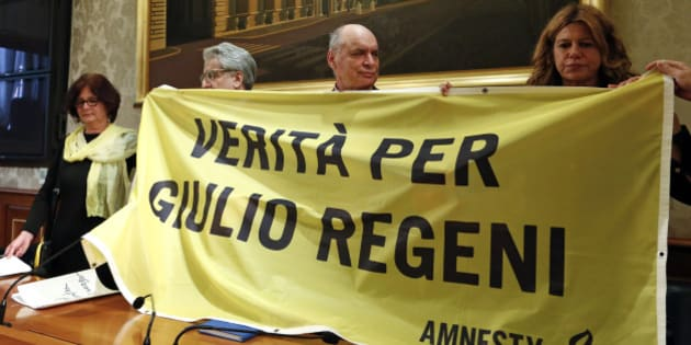 "(From L to R) Paola Regeni, Senator Luigi Manconi, Claudio Regeni and lawyer Alessandra Ballerini hold a banner reading ""Truth for Giulio Regeni"", the Italian student murdered in Egypt, during a news conference at the upper house of the parliament in Rome, Italy, March 29, 2016. REUTERS/Remo Casilli"