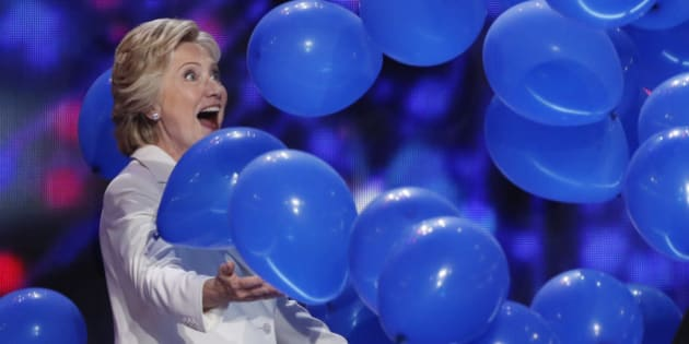 Democratic U.S. presidential nominee Hillary Clinton celebrates with balloons after she accepted the nomination on the last night of the Democratic National Convention in Philadelphia, Pennsylvania, U.S. July 28, 2016. REUTERS/Mike Segar