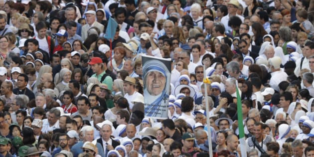 Faithful and pilgrims wait to enter in St. Peter's Square at the Vatican before a canonization ceremony, Sunday, Sept. 4, 2016. Thousands of pilgrims thronged to St. Peter's Square on Sunday for the canonization of Mother Teresa, the tiny nun who cared for the world's most unwanted and became the icon of a Catholic Church that goes to the peripheries to tend to lost, wounded souls. (AP Photo/Alessandra Tarantino)