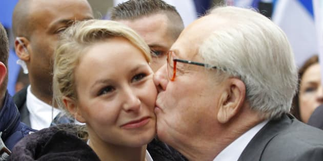 Marion Marechal-Le Pen, left, niece of far-right National Front party leader Marine Le Pen, receives a kisses from her grandfather, former leader and honorary president of the National Front party Jean-Marie Le Pen during the traditional May Day march in Paris, Wednesday May 1, 2013. (AP Photo/Jacques Brinon)