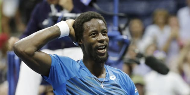 Gael Monfils, of France, reacts after beating Lucas Pouille, of France, during the quarterfinals of the U.S. Open tennis tournament, Tuesday, Sept. 6, 2016, in New York. (AP Photo/Julio Cortez)