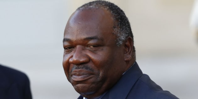 FILE-In this file photo taken on Tuesday, Nov. 10, 2015, Gabon's President Ali Bongo Ondimba, leaves the Elysee Palace after a meeting with French President Francois Hollande as part of preparation of the upcoming COP21 Climate Conference in Paris, France. Voting has started in Gabon, where the president is trying to overcome a coalition of high-profile opponents to win re-election and maintain a family dynasty that stretches back to the 1960s. (AP Photo/Francois Mori, File)