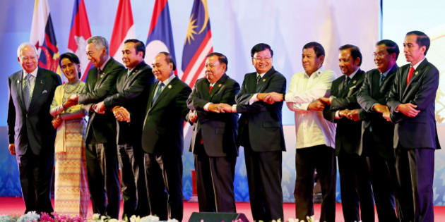 Southeast Asian leaders link arms at the opening of the 28th and 29th ASEAN Summits and other related summits in the National Convention Center Tuesday, Sept. 6, 2016 in Vientiane, Laos. From left to right; Malaysia's Prime Minister Najib Razak, Myanmar's Foreign Minister Aung San Suu Kyi, Singapore's Prime Minister Lee Hsien Loong, Thailand's Prime Minister Prayuth Chan-ocha, Vietnam's President Tran Dai Quang, Laos' President Bounnhang Vorachith, Laos' Prime Minister Thongloun Sisoulith, Philippines' President Rodrigo Duterte, Brunei's Sultan Hassanal Bolkiah, Cambodia's Prime Minister Hun Sen and Indonesia's President Joko Widodo. (AP Photo/Bullit Marquez)