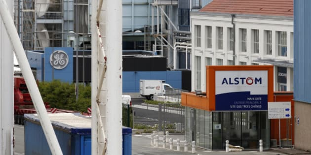 The logos of French power and transport engineering company Alstom and U.S. conglomerate General Electric are pictured on their site in Belfort, June 23, 2014. France will be making a sound investment by taking a stake in Alstom, its chief executive said on Monday, adding however that the government would be buying in too late to have a say in the use of proceeds from its tie-up with General Electric. France won an option to buy 20 percent of Alstom from conglomerate Bouygues on Sunday, in an eleventh-hour deal clearing the way for the agreed sale of most of Alstom's energy business to GE.  REUTERS/Vincent Kessler (FRANCE - Tags: ENERGY BUSINESS EMPLOYMENT)