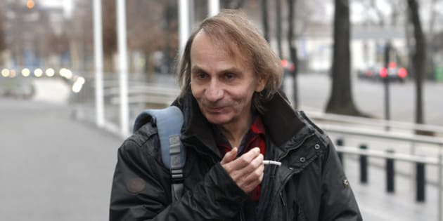 """FOR STORY SLUGGED EU BOOKS HOULLEBECQ SUBMISSION BY GREG KELLER  - This Wednesday, Jan. 7, 2015 photo shows French novelist Michel Houellebecq after an interview on radio station France Inter, in Paris. The latest novel by Michel Houellebecq, the bad boy of French letters, has been called everything from an Islamophobic rant to a """"French literary suicide."""" Imagining the election of a Muslim president in France, """"Submission"""" struck a raw nerve when it came out this year on the same day as the Charlie Hebdo attacks in Paris. (AP Photo/Thibault Camus)"""