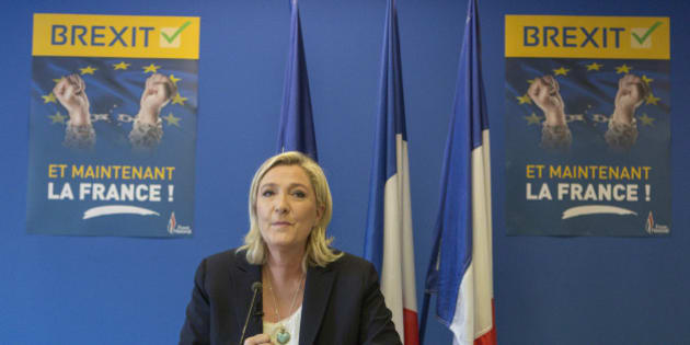French far-right leader Marine Le Pen speaks during a press conference at the National Front party headquarters in Nanterre, outside Paris, Friday, June 24, 2016. Le Pen says pro-independence movements in the European Parliament will meet soon to plan their next move after the British vote to leave the European Union. Poster behind reads:  Brexit. And now, France.  (AP Photo/Kamil Zihnioglu)