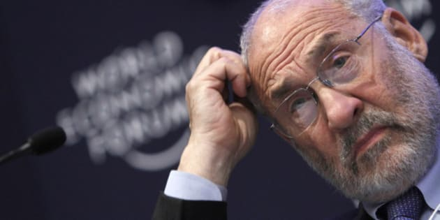** EMBARGOED UNTIL 12:01 A.M. EDT WEDNESDAY, MARCH 30, 2011 ** FILE - In this Jan. 26, 2011 file photo, Columbia University professor Joseph Stiglitz scratches his head during a session at the World Economic Forum in Davos, Switzerland. Stiglitz and others worry that too much money flowing to developing economies will form bubbles in stocks and housing prices that could burst. Such money has already inflated worldwide commodity prices to historic levels. (AP Photo/Virginia Mayo, file)