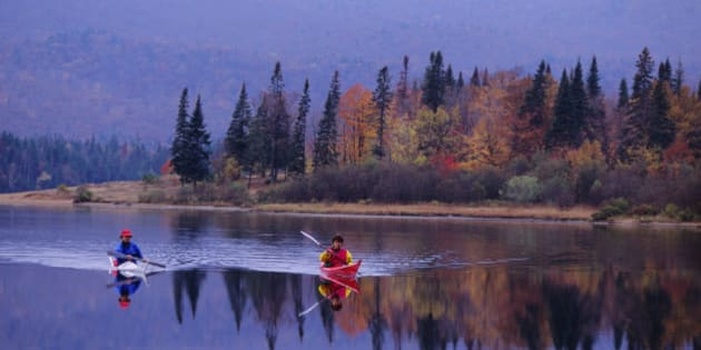 QUEBEC, CANADA - 1992/10/15: People kayaking in the fall on Lake Lac-Monroe, Mont-Tremblant National Park, in the Laurentians in Quebec Province, Canada. (Photo by Wolfgang Kaehler/LightRocket via Getty Images)