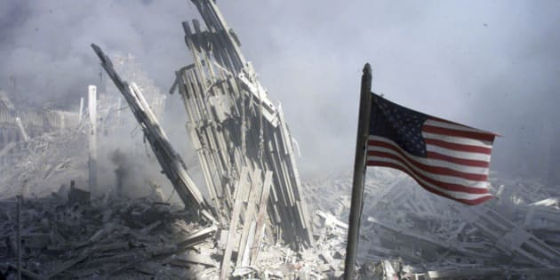 An American flag flies near the base of the destroyed World Trade Center after planes crashed into each of the two towers, causing them to collapse in New York, U.S. on September 11, 2001.   REUTERS/Peter Morgan/File Photo