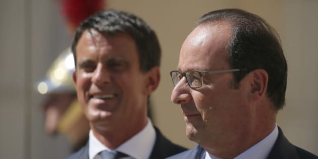 French President Francois Hollande (R) speaks with Prime Minister Manuel Valls before a meeting with European social democratic leaders at the castle of La Celle-Saint-Cloud, near Paris, France, August 25, 2016. REUTERS/Gonzalo Fuentes