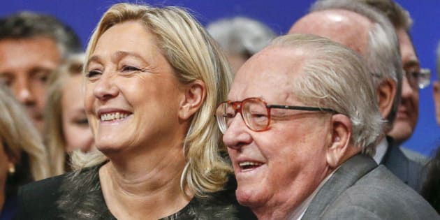 "Marine Le Pen (L), France's National Front political party leader, reacts with her father Jean-Marie Le Pen (R) during their party congress in Lyon in this November 30, 2014 file photo. French National Front founder Jean-Marie Le Pen rejected on Friday April 10, 2015 a call from his daughter, the party's leader, to leave politics over comments he made that she fears will hurt her push to widen the right-wing party's appeal. Marine Le Pen said on Thursday she would seek disciplinary action against her father after the 86-year-old was quoted this week calling France's Spanish-born Prime Minister Manuel Valls ""the immigrant"".  Picture taken November 30, 2014.   REUTERS/Robert Pratta/Files"