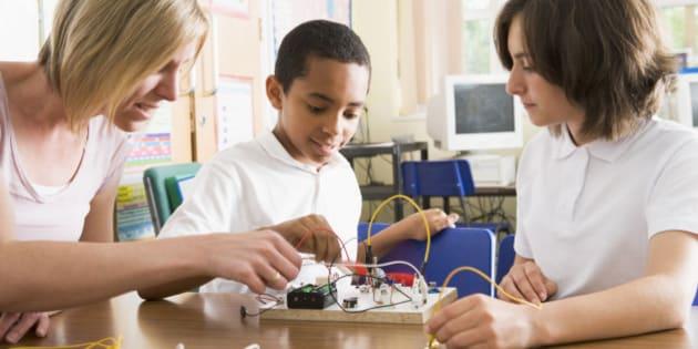 Schoolchildren and their teacher in a science clas