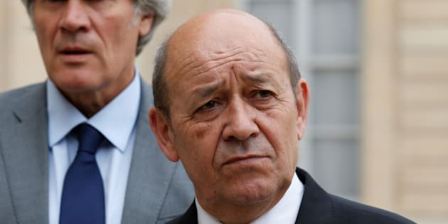 French Defence minister Jean-Yves Le Drian (R) and Agriculture Minister and Government spokesperson Stephane Le Foll leave the Elysee Palace after a weekly cabinet meeting in Paris, France, July 27, 2016. REUTERS/Benoit Tessier