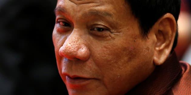 Philippine President Rodrigo Duterte arrives at the ASEAN Summit family photo in Vientiane, Laos September 7, 2016.  REUTERS/Jorge Silva