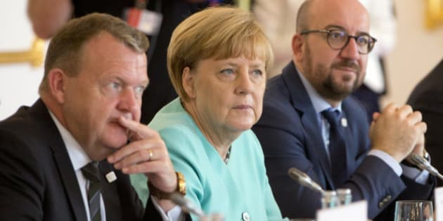 German Chancellor Angela Merkel, center, listens to the opening remarks at an EU summit at Bratislava Castle in Bratislava on Friday, Sept. 16, 2016. An EU summit, without the participation of the United Kingdom, in Bratislava will kick off the discussion on the future of the EU following Brexit. At left is Danish Prime Minister Lars Lokke Rasmussen and right is Belgian Prime Minister Charles Michel. (AP Photo/Virginia Mayo)