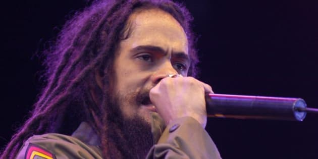 "Damian ""JR Gong"" Marley, son of late reggae superstar Bob Marley, opens the 30th Openair St. Gallen music festival, Saturday, July 1, 2006, in St. Gallen, Switzerland.  (AP Photo/Keystone, Regina Kuehne)"