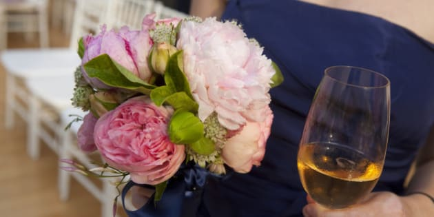 Bridesmaid with champagne and a bouquet