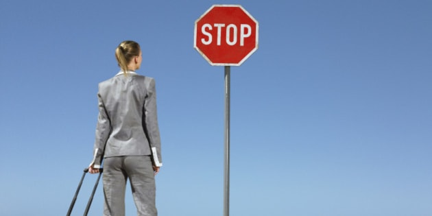 Businesswoman at Stop Sign