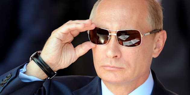 Russian Prime Minister Vladimir Putin adjusts his sunglasses as he watches an air show during MAKS-2011, the International Aviation and Space Show, in Zhukovsky, outside Moscow, on August 17, 2011. AFP PHOTO / DMITRY KOSTYUKOV / AFP / DMITRY KOSTYUKOV        (Photo credit should read DMITRY KOSTYUKOV/AFP/Getty Images)