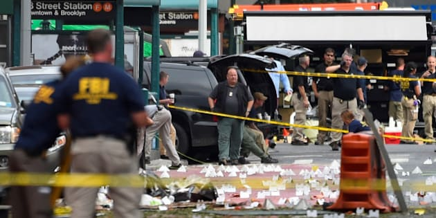 Federal Bureau of Investigation (FBI) officials stand amid the site of an explosion which took place on Saturday night in the Chelsea neighborhood of Manhattan, New York, U.S.  September 18, 2016.  REUTERS/Rashid Umar Abbasi