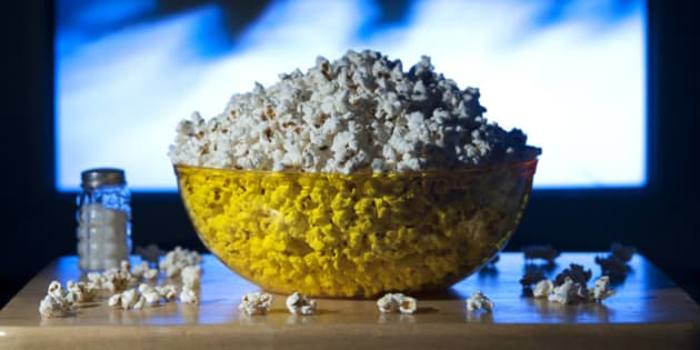Bowl of popcorn on a tv tray in the living room