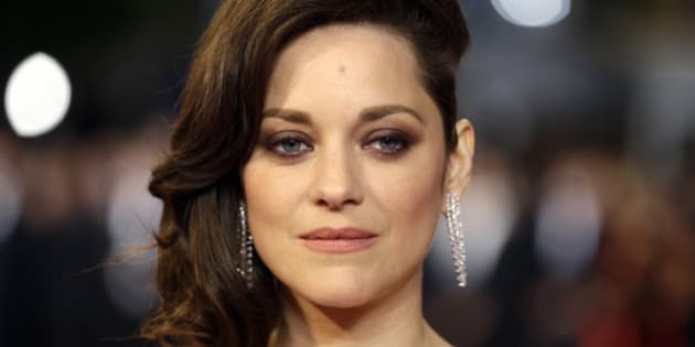 "FILE - In this May 19, 2016 file photo, actress Marion Cotillard poses for photographers upon arrival at the screening of the film Juste la Fin du Monde (It's Only the End Of The World) at the 69th international film festival, Cannes, southern France. Cotillard is announcing her pregnancy and shooting down rumors of any romantic involvement with Brad Pitt. The actress says in a statement posted Wednesday, Sept. 21, 2016, on Instagram that she is ""not used to commenting on things like this nor taking them seriously but as this situation is spiraling and affecting people I love, I have to speak up."" (AP Photo/Lionel Cironneau, File)"